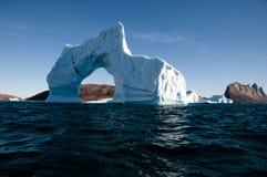 Iceberg - Scoresbysund Fjord - Greenland. Giant iceberg with a massive opening Stock Image