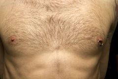 Pierced Nipple On Man's Chest Royalty Free Stock Photography