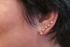 Piercing in the ear stock photo