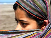 Piercing Eyes. The piercing eyes of an Indian woman dressed like an Arabic woman Stock Image