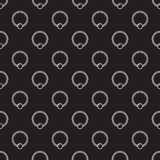 Piercing vector seamless pattern made with captive ring icons. Piercing jewelry dark vector seamless pattern made with outline captive ring icons Royalty Free Stock Photography