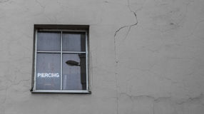 Piercing white light sign on a window in an old building Royalty Free Stock Photography