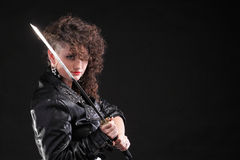Piercing woman curly girl and sword Stock Images