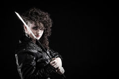 Piercing woman curly girl and sword Stock Photo