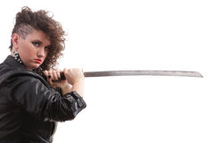 Piercing woman curly girl and sword Royalty Free Stock Photography