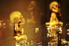 Piercings and monkey skeleton sculptures stock photo