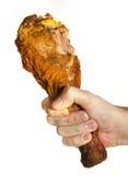 Pierna de Turquía en la mano masculina Fotos de archivo