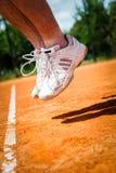 Pierna del jugador de tenis Imágenes de archivo libres de regalías