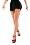 Piernas atractivas en Mini Skirt negro Imágenes de archivo libres de regalías