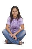 Piernas cruzadas sentada de la mujer fotografía de archivo