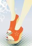 Piernas de la muchacha en zapatos. Fotos de archivo