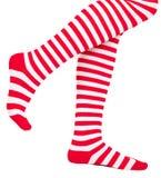 Piernas de la mujer en calcetines del rojo del color Imagen de archivo libre de regalías
