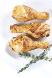 Piernas de pollo asadas con tomillo Foto de archivo libre de regalías