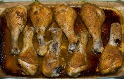 Piernas de pollo cocidas en el horno Imagen de archivo libre de regalías