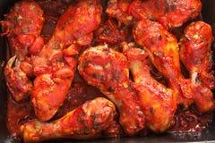Piernas de pollo con la salsa de tomate Imagen de archivo libre de regalías