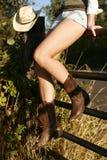 Piernas del Cowgirl Fotografía de archivo