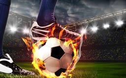 Piernas del futbolista del fútbol o imagen de archivo