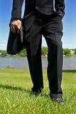 Piernas del hombre de negocios Fotos de archivo