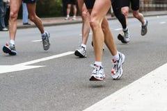 Piernas del maratón Foto de archivo libre de regalías