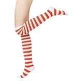 Piernas en calcetines rojos y blancos Imagen de archivo