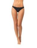 Piernas femeninas en bragas negras del bikini imágenes de archivo libres de regalías