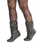 Piernas femeninas en pantyhose y zapatos Fotos de archivo libres de regalías