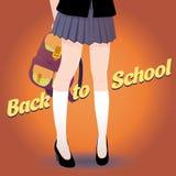Piernas japonesas de la colegiala con el bolso y las letras de nuevo a escuela en estilo retro Foto de archivo libre de regalías