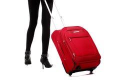 Piernas rojas de la maleta y de las mujeres Foto de archivo libre de regalías