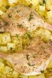 Piernas y patatas asadas del pato Fotografía de archivo libre de regalías