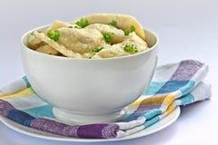 Pierogi. Traditional cooked polish dumplings in white bowl Stock Photos