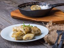 Pierogi (dumplings with sauerkraut and mushrooms) Stock Photo