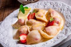Pierogi with strawberries Stock Photo