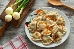 Pierogi, Varenyky, vareniki, pierogi, pyrohy с завалкой, вареником, традиционным блюдом восточно-европейской кухни стоковые изображения