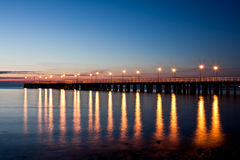 Pierr in the morning. Sunrise over the sea, view of the beautifully lit pier royalty free stock images