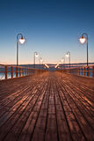 Pierr in the morning. Sunrise over the sea, view of the beautifully lit pier royalty free stock photos