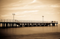Pierr in the morning. Sunrise over the sea, view of the beautifully lit pier stock images