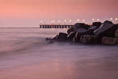 Pierr in the morning. Sunrise over the sea, view of the beautifully lit pier stock image