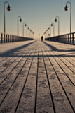 Pierr in the morning. Sunrise over the sea, view of the beautifully lit pier, Poland, Orłowo stock photography