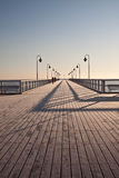 Pierr in the morning. Sunrise over the sea, view of the beautifully lit pier, Poland, Orłowo royalty free stock image