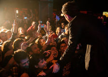 Pierre Bouvier, singer of Simple Plan band, surrounded by his fans Stock Image