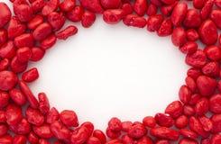 Pierre rouge créative sur le blanc photos stock