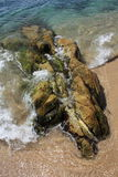 Pierre sur la plage Image libre de droits