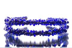 Pierres de couleur bleue sur la jante pour la tête photographie stock libre de droits