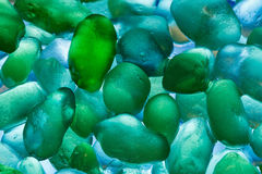 Pierres de mer de plan rapproché Modèle abstrait avec les pierres colorées Photos libres de droits