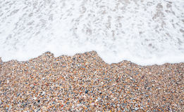 Pierres de mer et onde de mer photo libre de droits