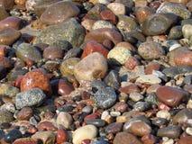 Pierres et cailloux sur la plage Images stock