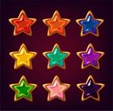 Pierres gemmes colorées d'étoile de bande dessinée Images stock