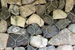 Pierres grises empilées sous forme de mur et photo libre de droits