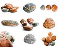 Pierres humides de mer d'isolement sur le fond blanc Ensemble de pierres de mer Photos stock