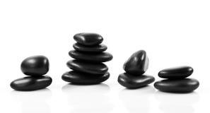 Pierres noires de massage empilées Image stock